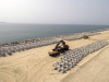 An aerial view of the Accropodes laid out to be placed on the Great Wall of Lagos
